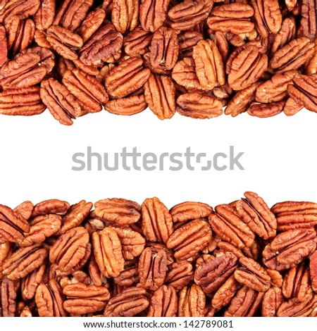 pecans in isolation in the middle, white background - stock photo