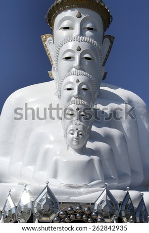 PECHABOON-THAILAND-JANUARY 17 : Close-up row of white Buddha statue on blue sky in temple.  January 17, 2015 Pechaboon Province, Thailand.