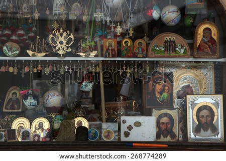PECHORY, RUSSIA - JANUARY 25, 2011: Orthodox icons in a icon shop in the Pskovo-Pechersky Monastery (Pskov Monastery of the Caves) near Pskov, Russia.  - stock photo