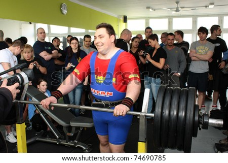 PECS - JANUARY 29: Unknown man participates in Amateur bench press championship in Professors GYM January 29, 2011 in Pecs, Hungary.