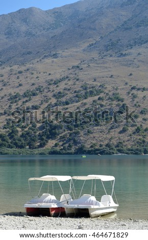 Pedalo boats on the shore of Lake Kournas in Crete, Greece