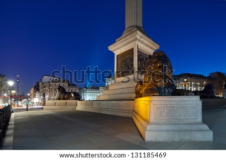 Pedestal Nelson's Column in Trafalgar Square with four lions lying. Shooting in low light. In the background - Big Ben. Cityscape  shot with tilt-shift lens maintaining verticals - stock photo