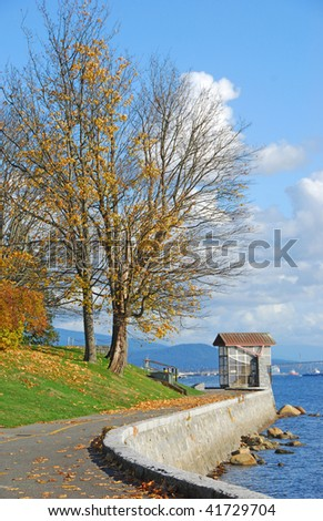 pedestrain path with watch house at the Stanley Park, Vancouver, British Columbia, Canada, North America - stock photo