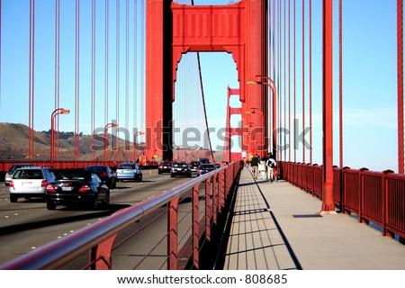 Pedestrian and auto traffic, Golden Gate Bridge - stock photo