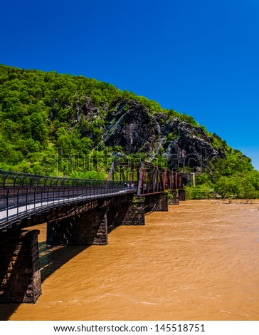 Pedestrian and train bridge across the flooded Potomac River in Harper's Ferry, West Virginia. - stock photo
