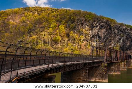 Pedestrian and train bridge over the Potomac River in Harper's Ferry, West Virginia. - stock photo