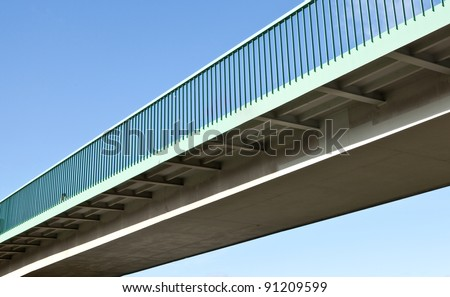 Pedestrian bridge against blue sky - stock photo