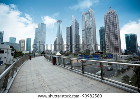 pedestrian bridge leading to the lujiazui financial center district in shanghai - stock photo