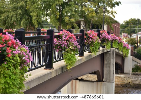 Pedestrian bridge  lined with hanging flowers,River Walk,Northfield Minnesota