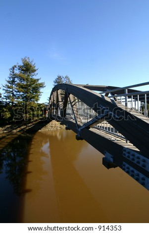 Pedestrian Bridge over waterway - stock photo