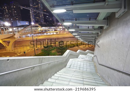 Pedestrian bridge perspective  long corridor of night