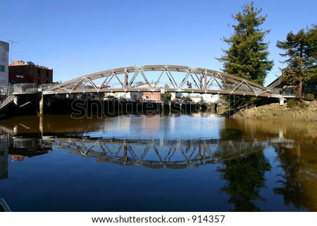 pedestrian bridge reflection - stock photo