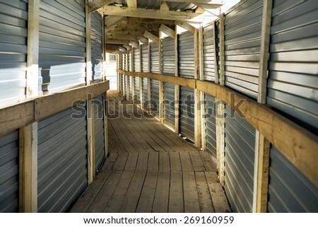 pedestrian corridor tunnel on a building - stock photo