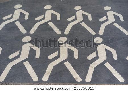 pedestrian cross sign on the asphalt - stock photo