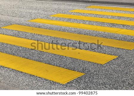 pedestrian crossing in yellow - stock photo