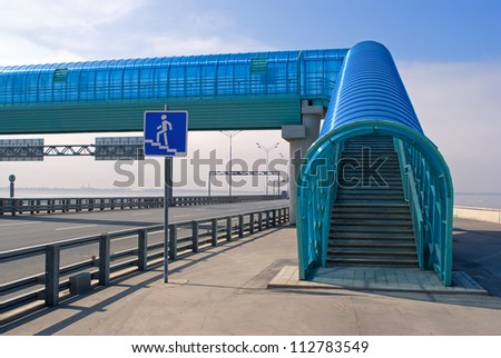 Pedestrian crossing over highway - stock photo