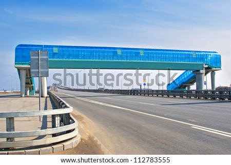 Pedestrian crossing over highway in summer day - stock photo