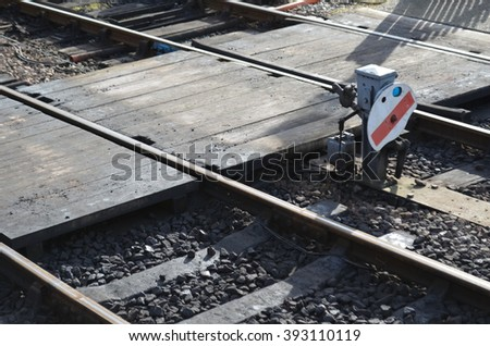Pedestrian crossing over steam railway track. - stock photo