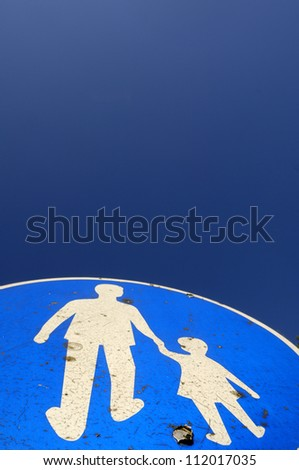 Pedestrian crossing sign, close-up, low angle view - stock photo