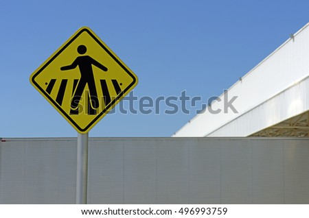 Pedestrian crossing sign in outdoor area of industrial plant - SEROPEDICA, RJ, BRAZIL - JANUARY 7, 2016