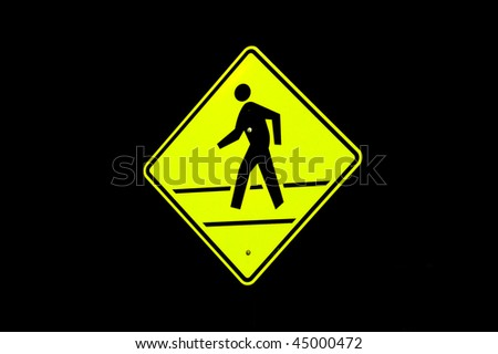 Pedestrian Crossing Sign with black background - stock photo