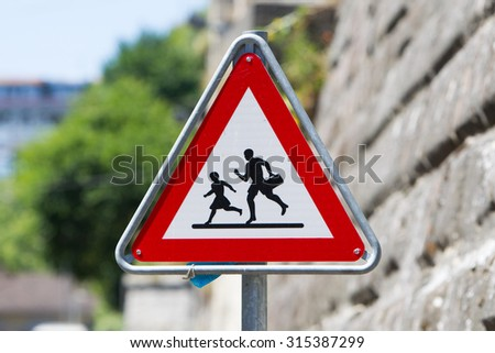 Pedestrian danger sign - Red triangle safety traffic sign, Switzerland - stock photo