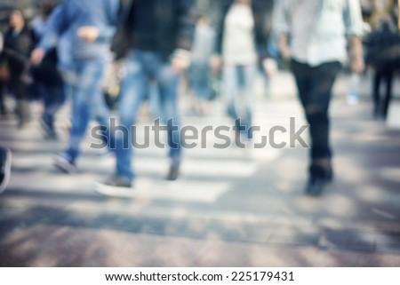pedestrian on zebra in motion blur - stock photo