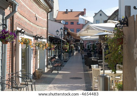 pedestrian passage with cafes in Klaipeda old town - stock photo