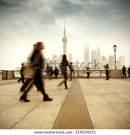 Pedestrian Shanghai Bund and Lujiazui skyscrapers - stock photo