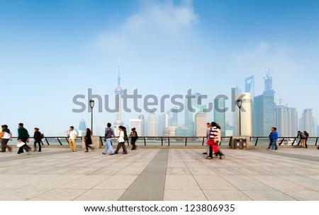 Pedestrian Shanghai Bund and Lujiazui skyscrapers - stock photo