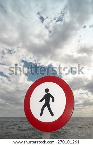 Pedestrian signal in a mediterranean coastline landscape. Alicante, Spain. Vertical - stock photo