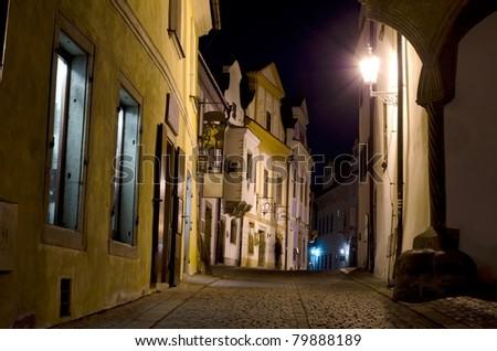 Pedestrian street at night, Cesky Krumlov, Czech Republic - stock photo