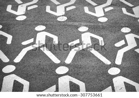 Pedestrian street sign on a gray asphalt   - stock photo