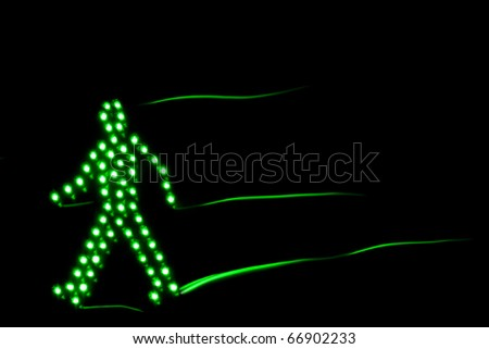 Pedestrian traffic light green, isolated on a black background - stock photo
