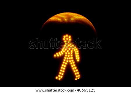 Pedestrian traffic light yellow, isolated on black background - stock photo