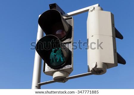 Pedestrian traffic lights with original girl lovers green signal, Vienna, Austria - stock photo