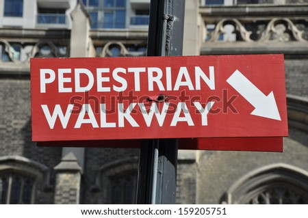 Pedestrian walkway arrow sign - stock photo