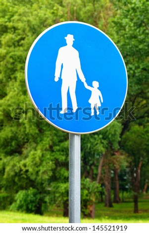 Pedestrian walkway road sign. Illustration of old man holding little girl by the hand. - stock photo