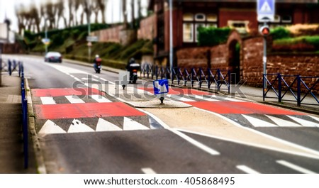 Pedestrian zebra across the street. Tilt shift view. - stock photo