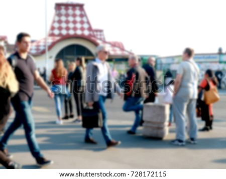 Pedestrians at bus station, blur background