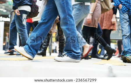 Pedestrians crossing a street. Urban rush hour  - stock photo