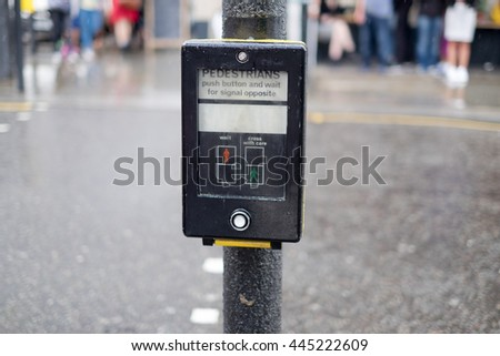 Pedestrians crossing sign in London - stock photo