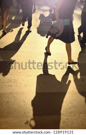 Pedestrians crossing the street (mostly women) after a day of work in Paris, France - stock photo