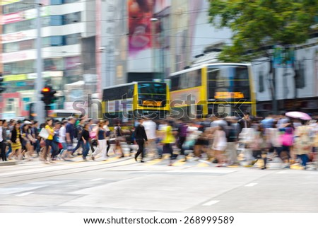 Pedestrians in Business District of Hong Kong - stock photo