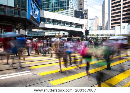 Pedestrians in Central of Hong Kong - stock photo