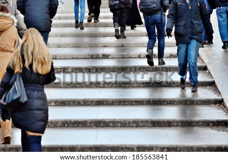 Pedestrians in stairs - stock photo