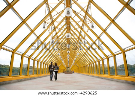 Pedestrians on pedestrian bridge - stock photo