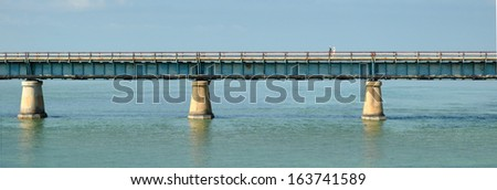 Pedestrians walking on the 7 Mile bridge, on the way to Key West in the sunshine state Florida. - stock photo