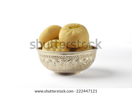 Pedha - a traditional indian sweet in a silver bowl. isolated image. - stock photo