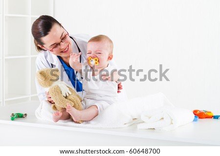 pediatrician and baby patient - stock photo
